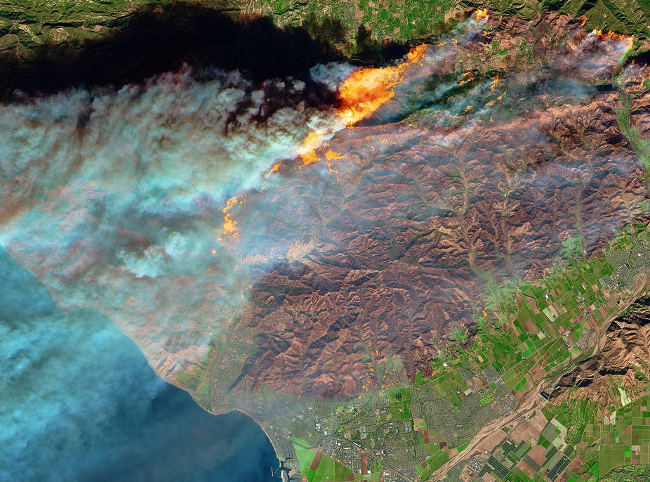 Satellite image of fire, mountains and a town