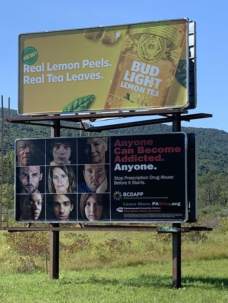 Highway billboard in Pennsylvania with diverse peoples' faces and the message, 'Anyone can become addicted. Anyone. Stop prescription drug abuse before it starts.'