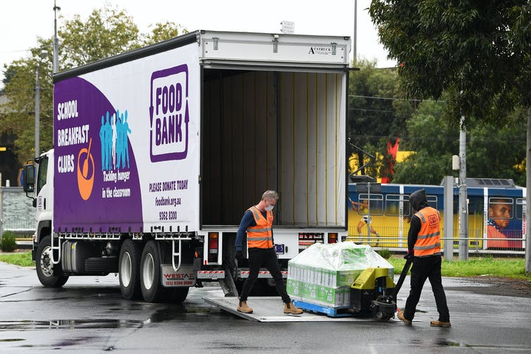 Food Bank workers unloading food aid off truck