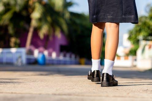 Back of school girl wearing uniform.