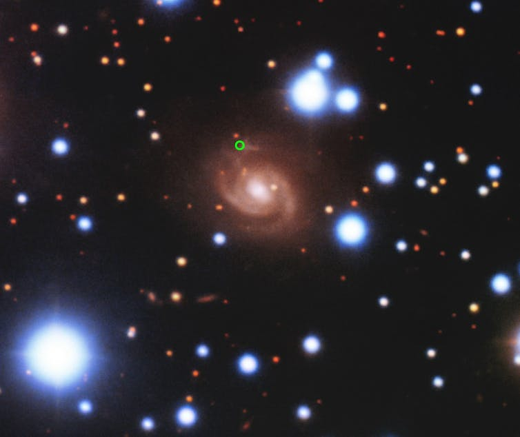 A photo showing multiple galaxies and stars against the backdrop of space