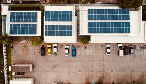 rooftop solar panels and parked cars