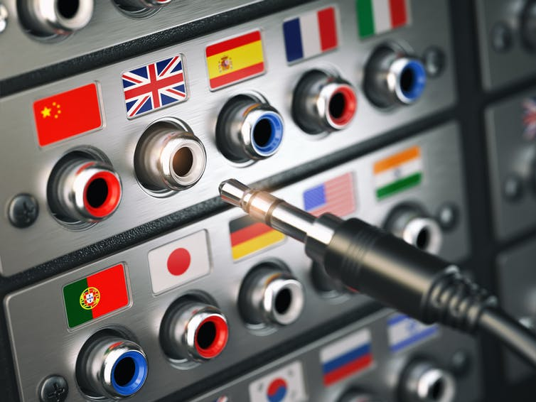 An audio input output/control panel with flags over each plug