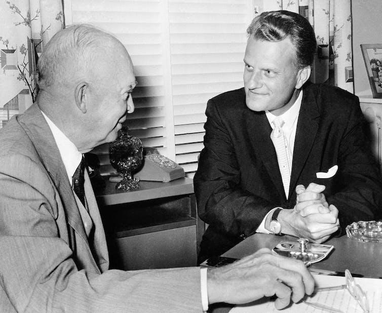 Rev. Billy Graham in a conversation with President Dwight Eisenhower.