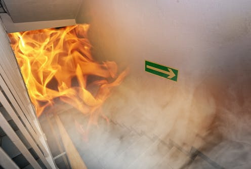 Simulated fire crawls up stairwell