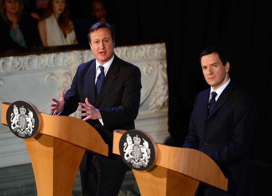 David Cameron and George Osborne giving a speech.