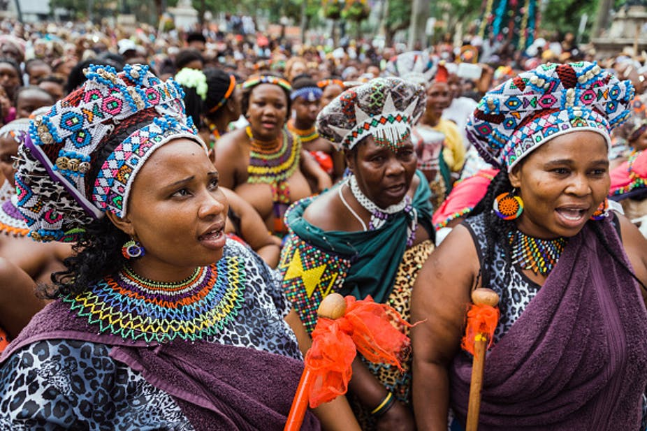 Hundreds of women dressed in Zulu attires at a march.