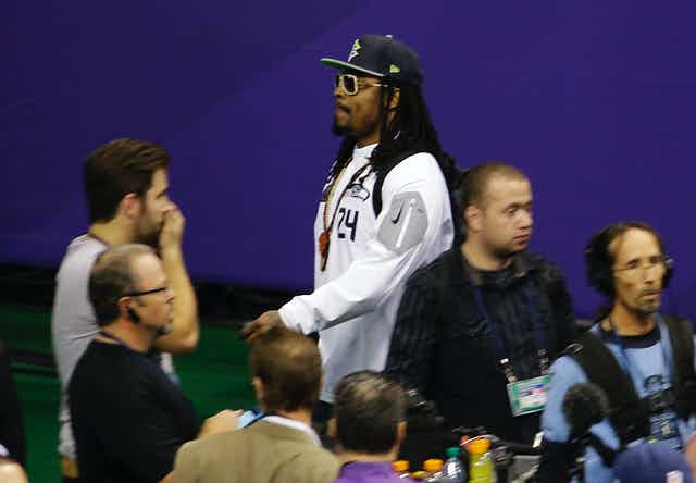 Seattle Seahaws running back Marshawn Lynch leaving a press conference before the 2015 Super Bowl.