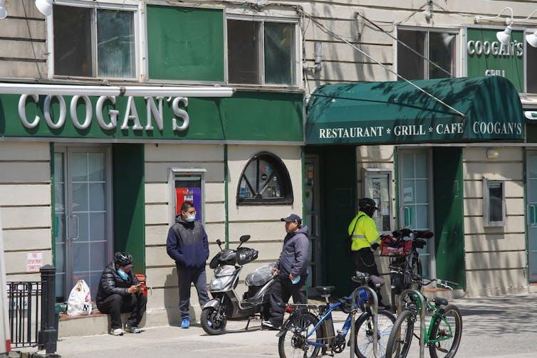 People congregate outside Coogan's restaurant.