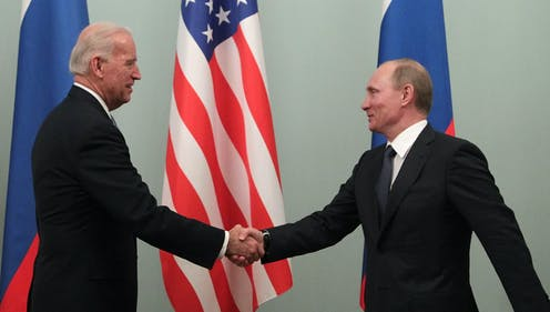 Joe Biden and Vladimir Putin shake hands during the then US vice president's 2011 trip to Moscow.