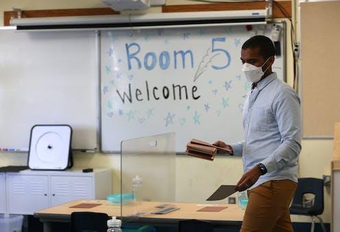 Teacher prepares his classroom before students arrive