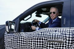Biden at the wheel of an electric F-150.