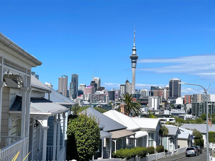 inner city houses in Auckland with Sky Tower in distance