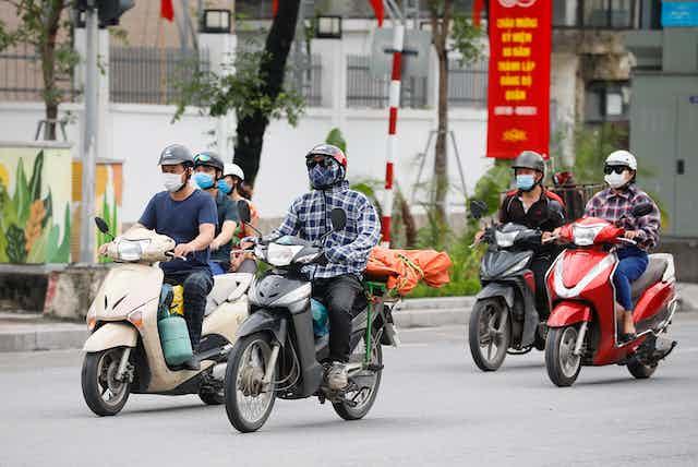 People riding motorbikes in Vietnam.