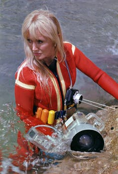 blonde woman in bright scuba suit