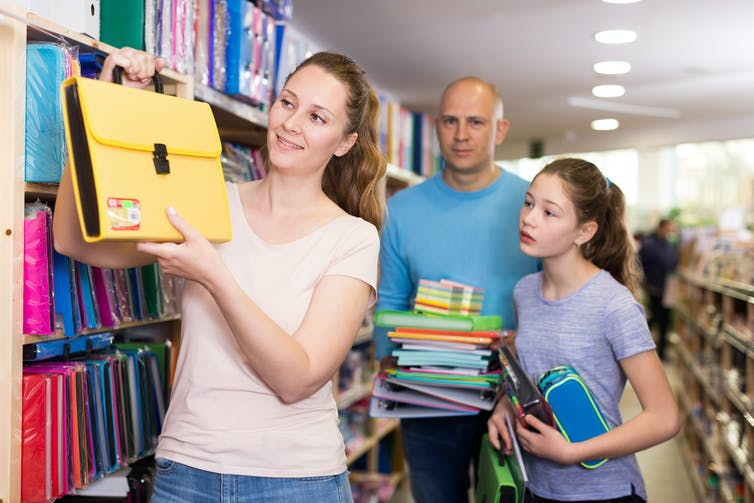 Family shopping for school stationery.