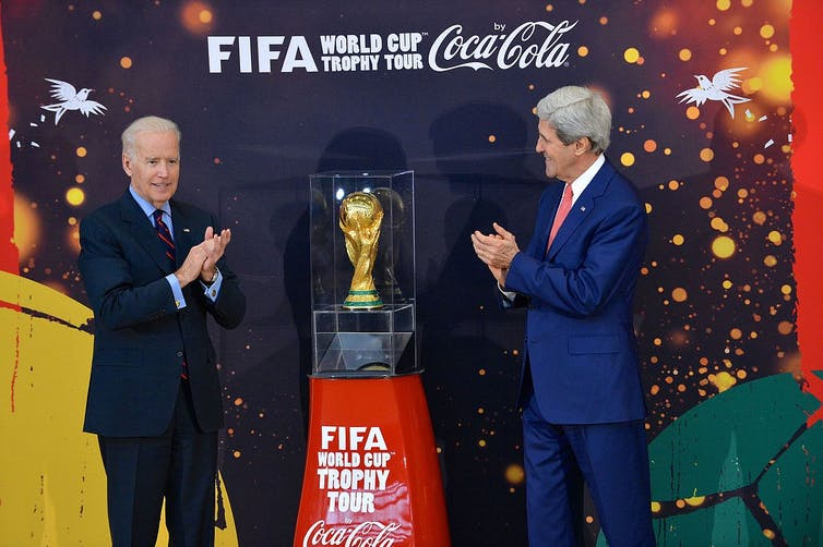 The world cup trophy surrounded by Coca-Cola advertising