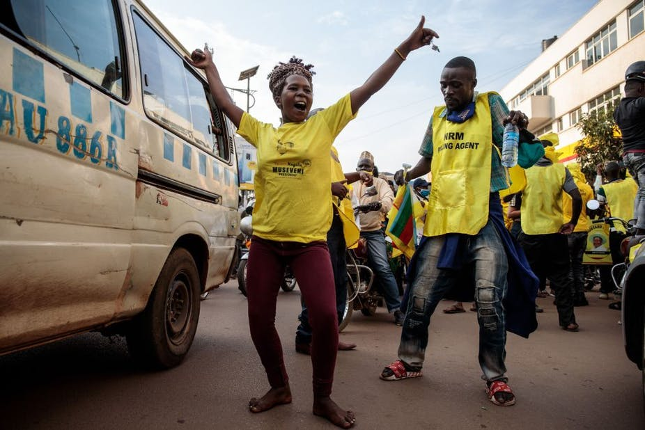 A woman celebrated following the re-election of President Museveni