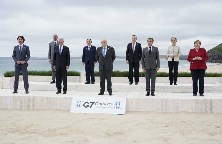 Leaders of the seven current nations in the G7 as well as of the European Commission and European Council stand and pose for a picture in Cornwall, England