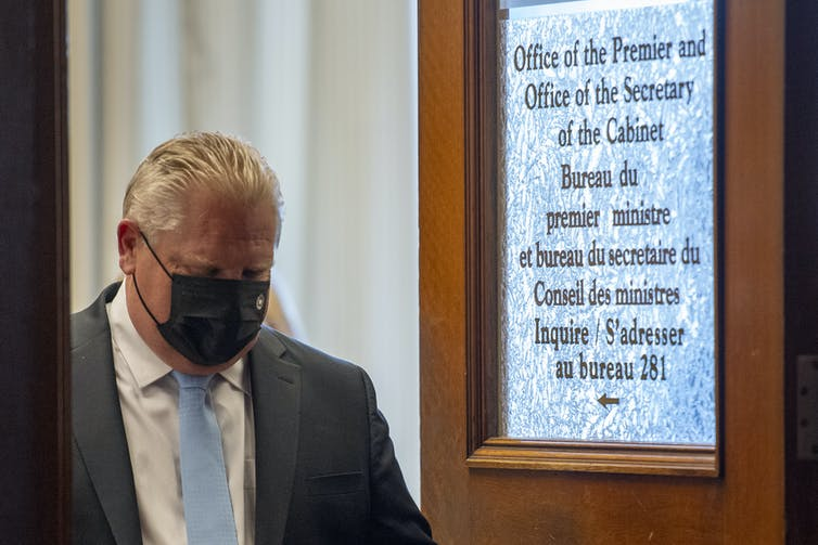 Ontario Premier Doug Ford leaves his office.