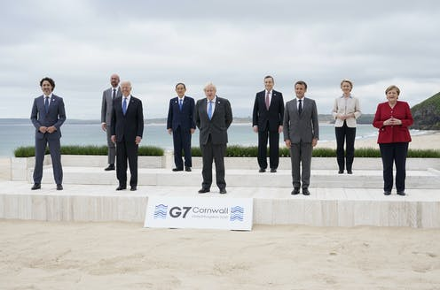 Leaders pose on a Cornwall beach at the G7 meeting