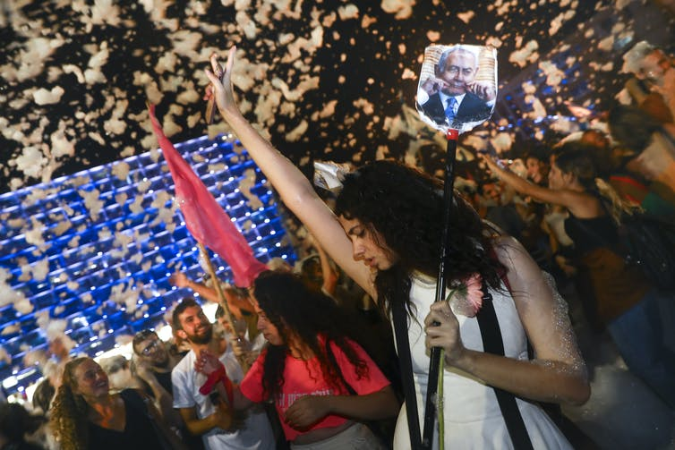 Israelis celebrate their new government.