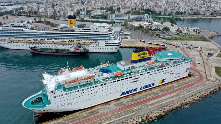 Two large cruise ships anchored at Piraeus port in Greece