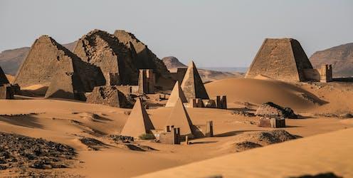 Pyramids on sand dunes
