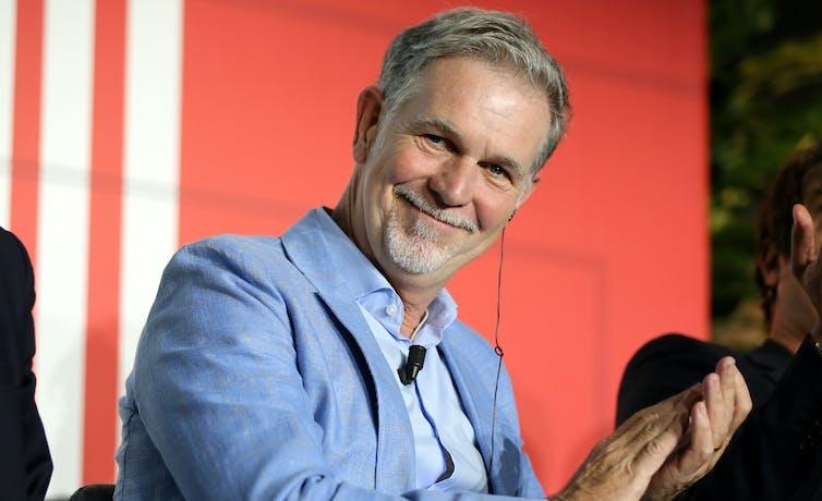 Netflix founder Reed Hastings applauds