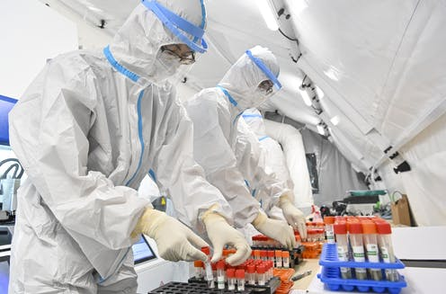 People working in a high-security laboratory