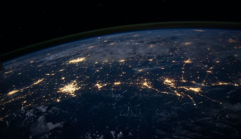 A shot of Earth from above at night.