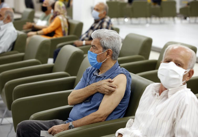 Older Iranian people waiting to be vaccinated.