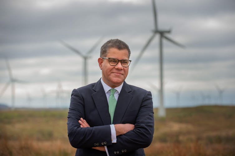 Alok Sharma, Conservative MP, stands in front of wind turbines