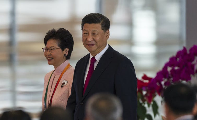 Chinese president Xi Jinping walks with Hong Kong's chief executive Carrie Lam in Guangdong province, China, October 2018.