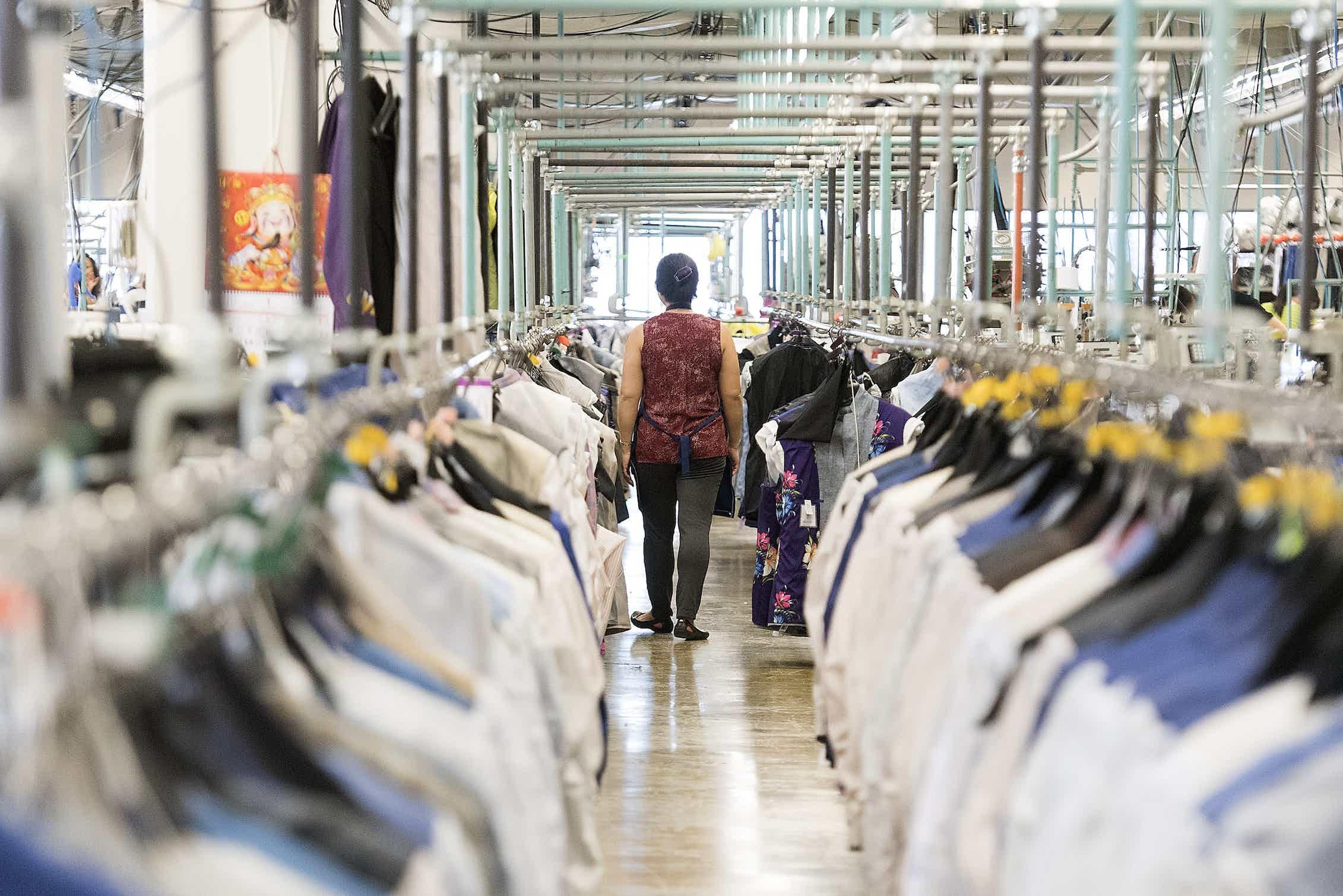 A garment worker walks through a clothing factory