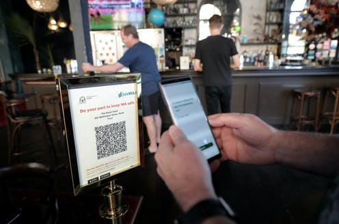 Close-up of someone scanning a QR code with the SafeWA app
