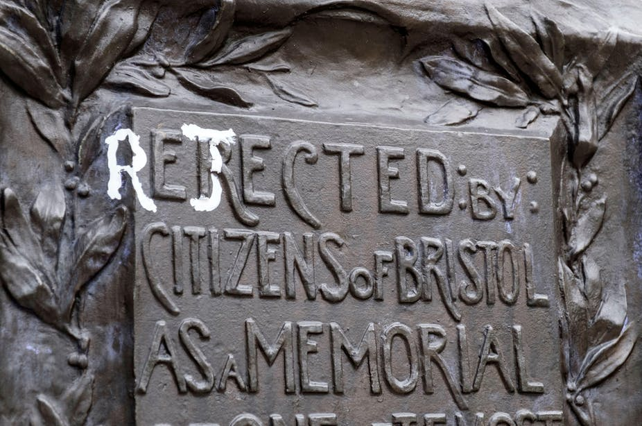The statue of Edward Colston in Bristol with the writing changed from 'erected by the citizens of Bristol as a memorial' to 'rejected by the citizens of Bristol as a memorial'.