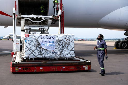 AstraZeneca vaccines from Covax vaccine sharing programme being unloaded from a plane at Entebbe International Airport, Uganda