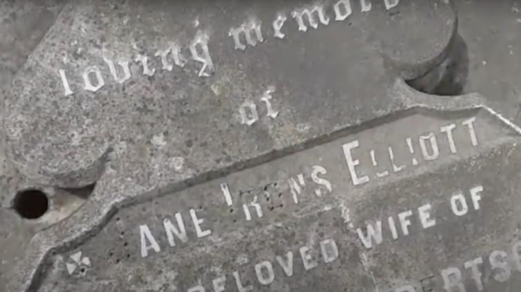 The battered gravestone of Scotswoman Jane Elliott in the Scottish cemetery in Calcutta.
