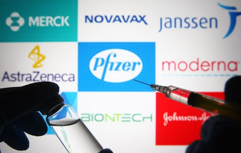 logos of vaccine-makers behind a syringe