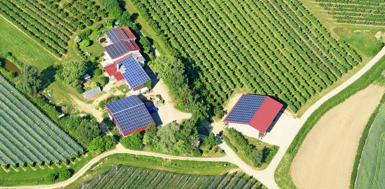 Aerial view of houses with solar panels