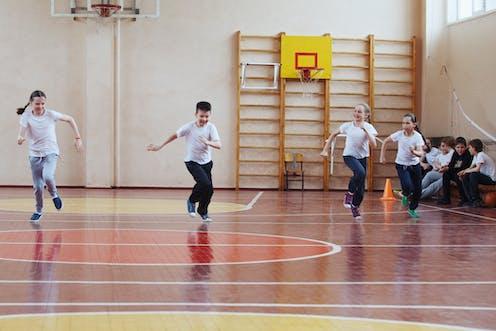 Kids running in gym.
