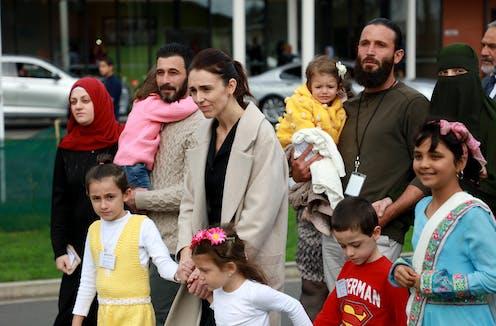 Jacinda Ardern with refugee children