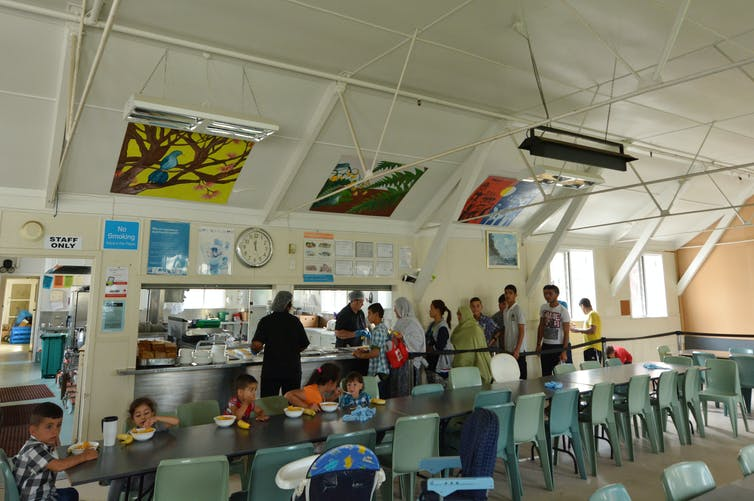 Refugees having lunch at the refugee centre in Auckland