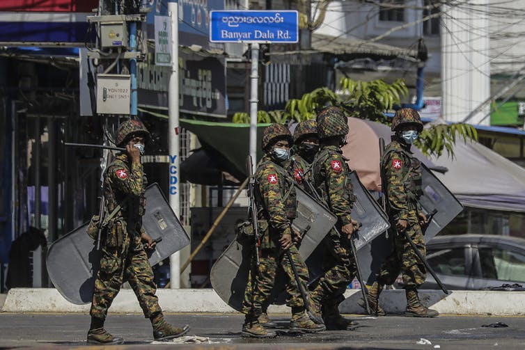 Members of Myanmar military patrol the streets of Yangon, March 2021.