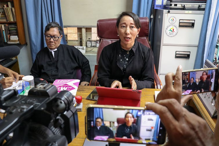 Aung San Suu Kyi's lawyers, Khine Maung Zaw (L) and Daw Min Min Soe (R) at a press conference in the capital Naypyitaw, Myanmar, May 2021.