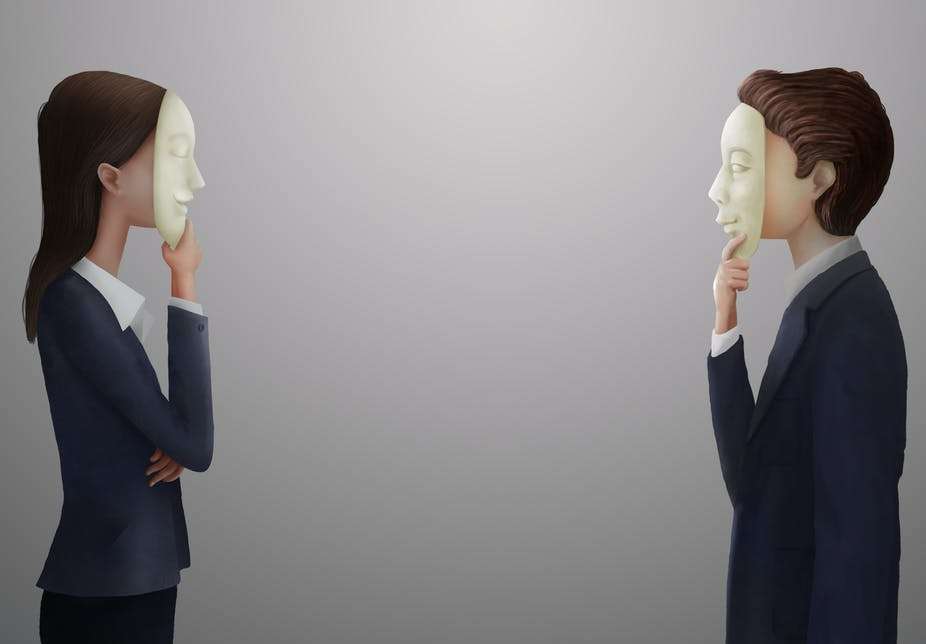 Man and woman in business attire with masks on