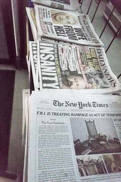 Stacks of newspapers.