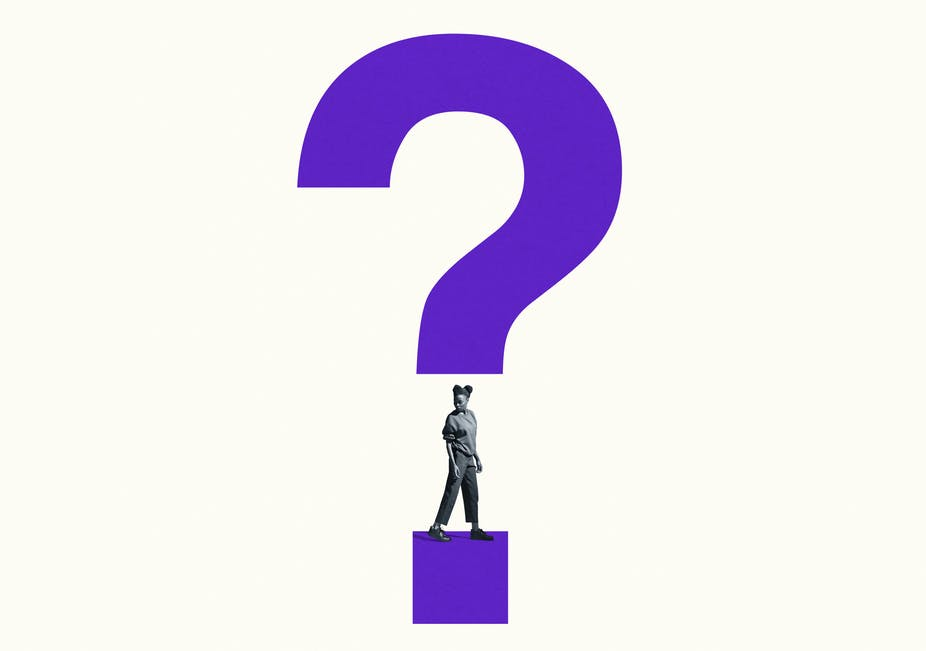A woman looks over her shoulder with a question mark superimposed over her.