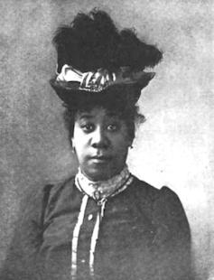 Pauline Hopkins poses for a portrait wearing a hat.